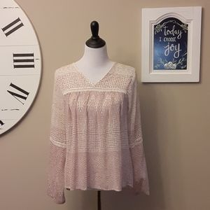Sheer blouse with crochet trim on sleeves and bodi